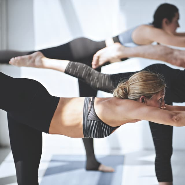 Group of women holding a pose in yoga class